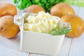 foto of mashed potatoes  - mashed potato in bowl and on a table - JPG