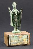 stock photo of figurines  - Chieftain praying with cloak and stick bronze figurine - JPG