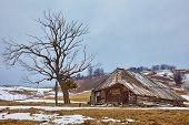 pic of abandoned house  - Winter landscape with an abandoned wooden house on the hills - JPG