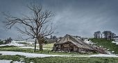 foto of abandoned house  - Winter landscape with an abandoned wooden house on the hills - JPG