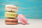 foto of french pastry  - Colorful macaroons delicious French pastries stacked on white wooden table - JPG