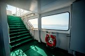stock photo of lifeline  - Ferry interior with lifeline stairs and window to the sea - JPG