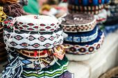 Постер, плакат: various colorful decorative knitted ribbons in hanks