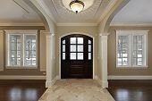stock photo of entryway  - Foyer in new construction home with mahogany wood door - JPG