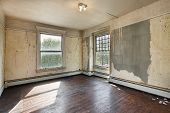 stock photo of forlorn  - Interior of a bedroom in an old abandoned home