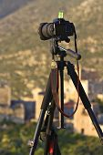 Camera on a tripod ready to shoot a landscape scenery in Mani, Greece