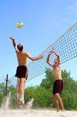 Two Men Playing Beach Volleyball - Short Balding Man Wins Over Tall Man