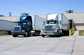 image of 18 wheeler  - This is a picture of 18 wheeler semi trucks loading at a warehouse building - JPG