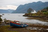 stock photo of carron  - A grounded fishing boat outside of Plockton - JPG