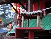 Chinese Birdfeeder With A Bamboo Roof In Twilight
