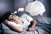 Man Comfortably Dreaming In His Bed With A Cloud
