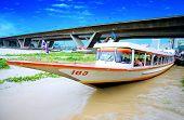 Chao Praya river,Bangkok Thailand Aug 2008.Several kinds of boats (express boats, river taxis and tail-boats) run up and down the Chao Phraya River, to transport passengers.