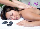 Woman having back massage therapy in spa