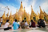 YANGON, MYANMAR - JAN 28: Buddhist devotees pray at the full moon festival, Shwedagon Pagoda, Januar