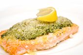 Fresh salmon steak with fresh basil pesto and sprinkling of parmesan