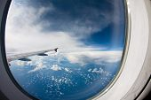 stock photo of float-plane  - Clouds and sky as seen through window of an aircraft - JPG