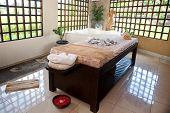 Beautiful spa therapy room with wooden windows in Bali