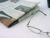 Glasses And Newspaper