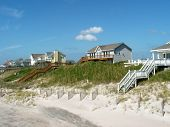 stock photo of beach-house  - beach houses and sand dunes on the north carolina coast - JPG