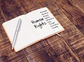 Human Rights Concept. Human Rights Mind Map With Hand Writing On Note Book At The Wooden Table poster