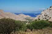 Looking down towards the coastline rom the hills above Emborio on the greek island of Halki.