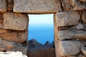 Looking through the window of the medieval Knights of Saint John crusader castle near Horio on the G
