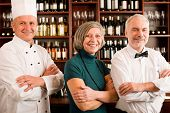 picture of chef cap  - Restaurant manager posing with chef cook and waiter wine bar - JPG