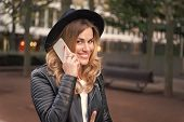 Happy Woman Talk On Mobile Phone In Paris, France. Sensual Woman With Long Blond Hair, Hairstyle, Be poster