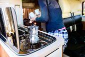 Cooking Coffee In Campervan, Caravan Or Rv On Camping Trip. poster