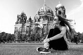 Carefree Girl Relax In Germany At Berlin Cathedral. Pretty Girl Relax On Summer Grass Near Berlin Ca poster