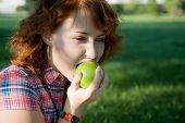 girl with green apples in the park