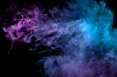 Multicolor, Thick Smoke, Illuminated By Colored In Blue, Purple And Pink Light Against A Dark Black  poster