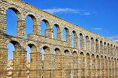 The well-known antique aqueduct and ancient Segovia in fine May day