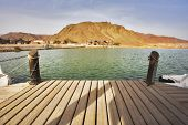 Boat mooring in small lake in grandiose park Timna