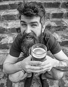 Guy Having Rest With Draught Beer. Hipster On Cheerful Face Drinking Beer Outdoor. Man With Beard An poster