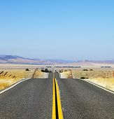 Abrupt bends of road on open spaces of the Californian steppes