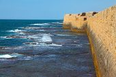 Superb kept protective fortification. Mediterranean sea, the ancient city of Akko, a sea surf