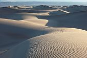 The famous Death Valley in California. Sand dunes are spectacular gold sunrise