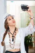 Portrait Of Beautiful Hippie Girl Making A Selfie With Antique Camera poster