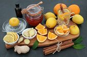 Natural flu and cold remedy with orange and lemon fruit, honey, eucalyptus oil, fresh ginger and cin poster