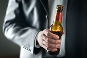 Business Man Drinking Beer. Businessman Holding Bottle Of Alcohol. Drunk Guy In Suit With Booze. Par poster