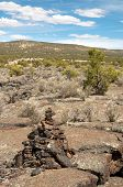 lava flow rock, trail marker and desert vegitation