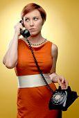 Woman using retro telephone