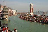 HARIDWAR, INDIA - JANUARY 14: Puja ceremony on the banks of Ganga river. People celebrate Makar Sankranti, huge Religious festival regarding Sun and Harvest, January 14, 2009 in Haridwar, India.