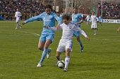 TOMSK, RUSSIA - APRIL 5: Football match Championship of Russia among Tom'(Tomsk) - Zenit (St.Petersb