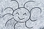 Smiling Sun Drawn On Snow.soft Focus. Background. Close-up.rozhitsy Drawn On Snow. Sun Drawn In The poster