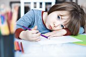 Portrait Kid Girl Holding Colour Pencil Sitting Alone And Looking Out With Bored Face poster