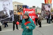 MOSCOW - MAY 1: Communist party supporters take part in a rally marking the May Day, a A portraits Vladimir Lenin of Josef Stalin and seen in the background, May 1, 2010 in Moscow, Russia.