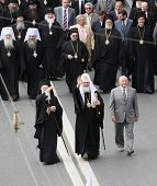 MOSCOW - MAY 24: Russian Patriarch Kirill (C), Patriarch Bartholomew (L) and Moscow Mayor Yuri Luzhkov (R), while celebrating the Holiday of St.Cyril and Methodius, May 24, 2010 in Moscow, Russia.