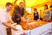 MOSCOW - JUNE 12: Celebrating the Day of Russia - at Revolution Square, cake divides Alexei Alexandr